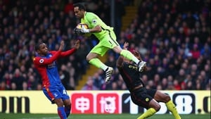 Vincent Kompany (R) is clattered by Claudio Bravo