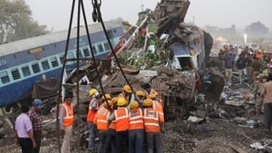Rescue workers at the site of the accident near Pukhrayan, in Kanpur, India