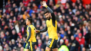 Olivier Giroud acknowledges the crowd following his equaliser