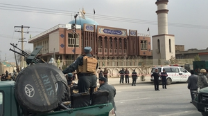 Afghan security officers cordoned off the area around the Baqirul Olum mosque