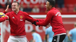 Wayne Rooney and Memphis Depay (but does he own a Chevrolet?)