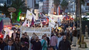 Protesters and peace activists take part in a peace rally in the northern part of Nicosia, in the self proclaimed Turkish Republic of Northern Cyprus