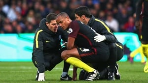 Vincent Kompany receives treatment following a clash with keeper Claudio Bravo