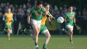 Corofin's Gary Sice (R) attempts to tackle Karol Mannion of St Brigid's in 2011