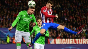 Atletico Madrid's French forward Kevin Gameiro (R) vies with PSV Eindhoven's defender Jordy De Wijs