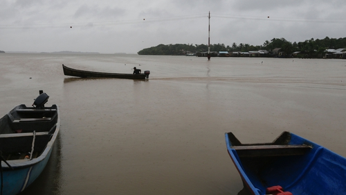 A man in his boat before Hurricane Otto hit Nicaragua