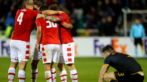 AZ Alkmaar players celebrate at the full-time whistle