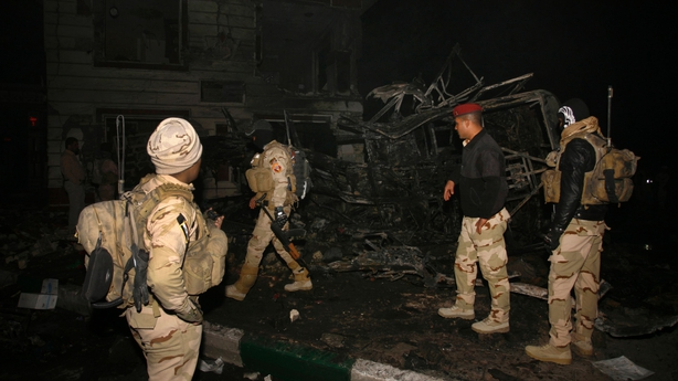 Iraqi security forces inspect the scene