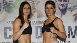 Katie Taylor (L) and Karina Kopinska pictured at the weigh-in for their bout tomorrow