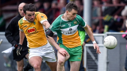 Rhode's Niall McNamee (right) proved the difference between the two sides, scoring eight points for the Offaly champions
