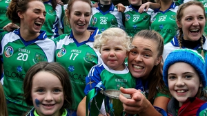 Two-year-old Aoibh Doran celebrates with her Auntie, Johnstownbridge Captain Jenna Murphy