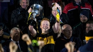 Crokes captain Johnny Buckley breaks the handle of the cup after lifting it up in Mallow
