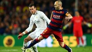 Iniesta shields possession in last season's Clasico at the Nou Camp