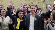 Liberal Democrat candidate Sarah Olney with her husband after her by-election win