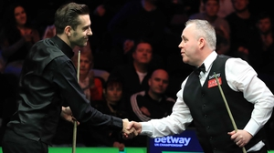 Mark Selby shakes hands with John Higgins