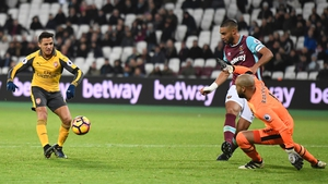 Alexis Sanchez of Arsenal gives West Ham's Irish goalkeeper Darren Randolph the eyes before dinking the ball into the net