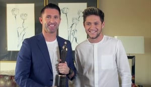 Robbie Keane receives his People of the Year Award from One Direction's Niall Horan in Los Angeles