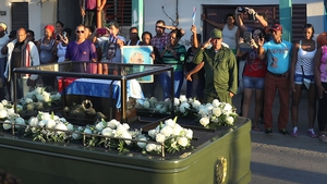 Thousands line the streets to watch the convoy carrying the ashes of late Cuban leader Fidel Castro arrive in Santiago