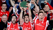 Cuala's Oisin Gough, David Treacy and Paul Schutte lift the Leinster trophy