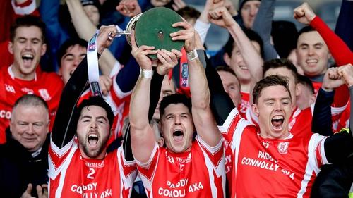 Cuala's Oisin Gough, David Treacy and Paul Schutte lift the Leinster trophy