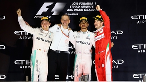 Sebastian Vettel on the podium in Abu Dhabi along with the now retired Nico Rosberg and Lewis Hamilton
