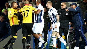 Roberto Pereyra of Watford and James McClean of West Bromwich Albion clash
