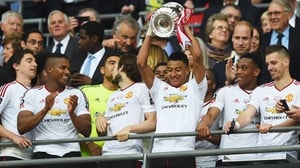 Winning goalscorer Jesse Lingard of Manchester United celebrates with the FA Cup