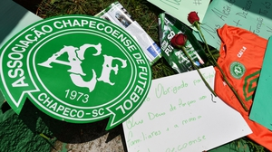 People pay tribute to the players of Chapecoense at the club's stadium in Chapeco