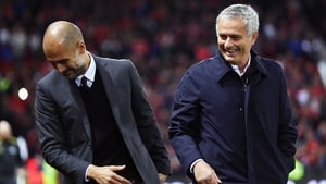 Pep Guardiola and Jose Mourinho share a joke prior to the League Cup clash in October