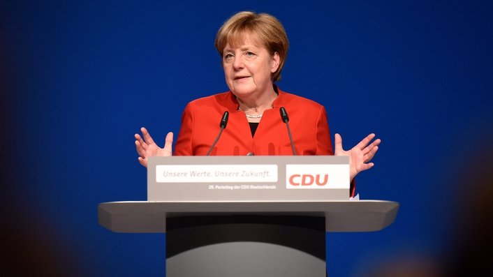 Merkel 'now a Chancellor by default'