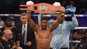Joshua in the ring with his IBF world heavyweight champion's belt