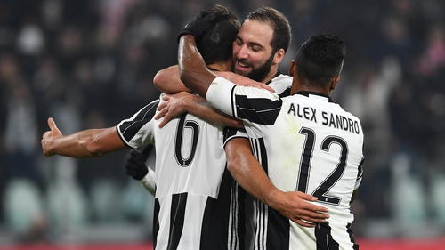 Gonzalo Higuain helped Juventus finish top of Group H