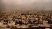 A general view of smoke rising over the city of Aleppo
