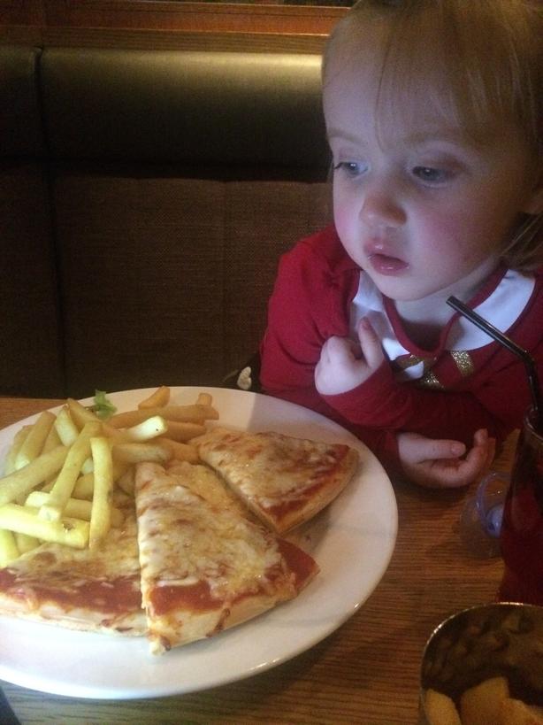 Paige eating Pizza Jurys Inn Belfast