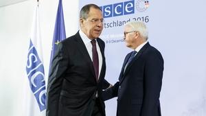 Sergei Lavrov (L) at the OSCE summit in Hamburg, Germany