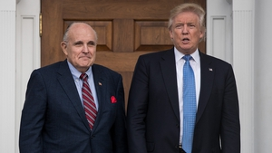 Rudy Giuliani (L) will remain on the presidential transition team