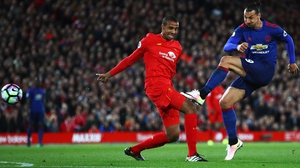 Joel Matip (L) has impressed this season