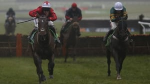 Richard Johnson riding The New One (L) clears the last to win The International Hurdle from My Tent Or Yours (R)