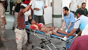 A wounded man arrives at hospital after the suicide bomb attack in Yemen's southern city of Aden
