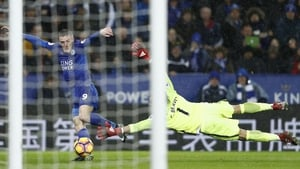 Jamie Vardy slides home against City