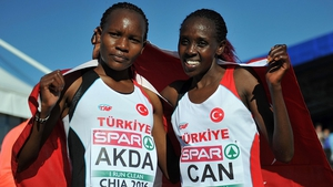 Silver medallist Meryem Akda and gold medallist Yasemin Can of Turkey pose after the European Cross Country Championships