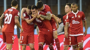 Vicente Iborra is mobbed by his Sevilla team-mates