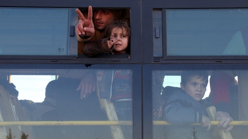 Syrians pictured on a bus out of eastern Aleppo