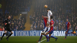 Diego Costa (C) jumps to score for Chelsea