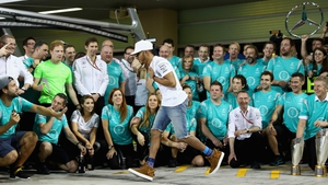 Lewis Hamilton runs from the team celebration before the champagne is sprayed at the Abu Dhabi GP