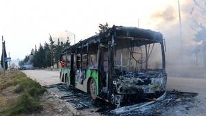 """Syrian state media said """"armed terrorists"""" burned five buses near Idlib"""