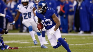 Odell Beckham Junior of the New York Giants carries the ball against the Detroit Lions