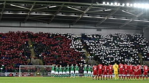 Northern Ireland and Azerbaijan stand for a minute's silence before the World Cup qualifier last month