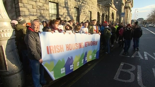 Supporters of the Apollo House occupiers outside the High Court