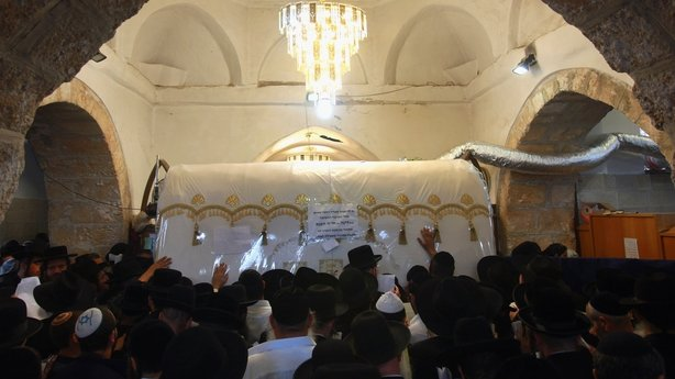 Ultra-Orthodox Jews pray at the tomb of the biblical matriarch Rachel, on October 29, 2009 in the West Bank Palestinian city of Bethlehem. Thousands of Jewish worshipers converged under tight Israeli security on Rachel's Tomb on the anniversary of her death.
